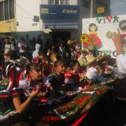 Girls in traditional Mexican dresses give out candy in the Desfile de los Charros, a parade celebrating regional cowboy practices and costumes on Sept. 13.