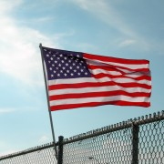 citizenship: flag on fence