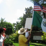 A_Day_Without_Immigrants_-_Gringo_also_protesting,_Mexican_and_American_flags