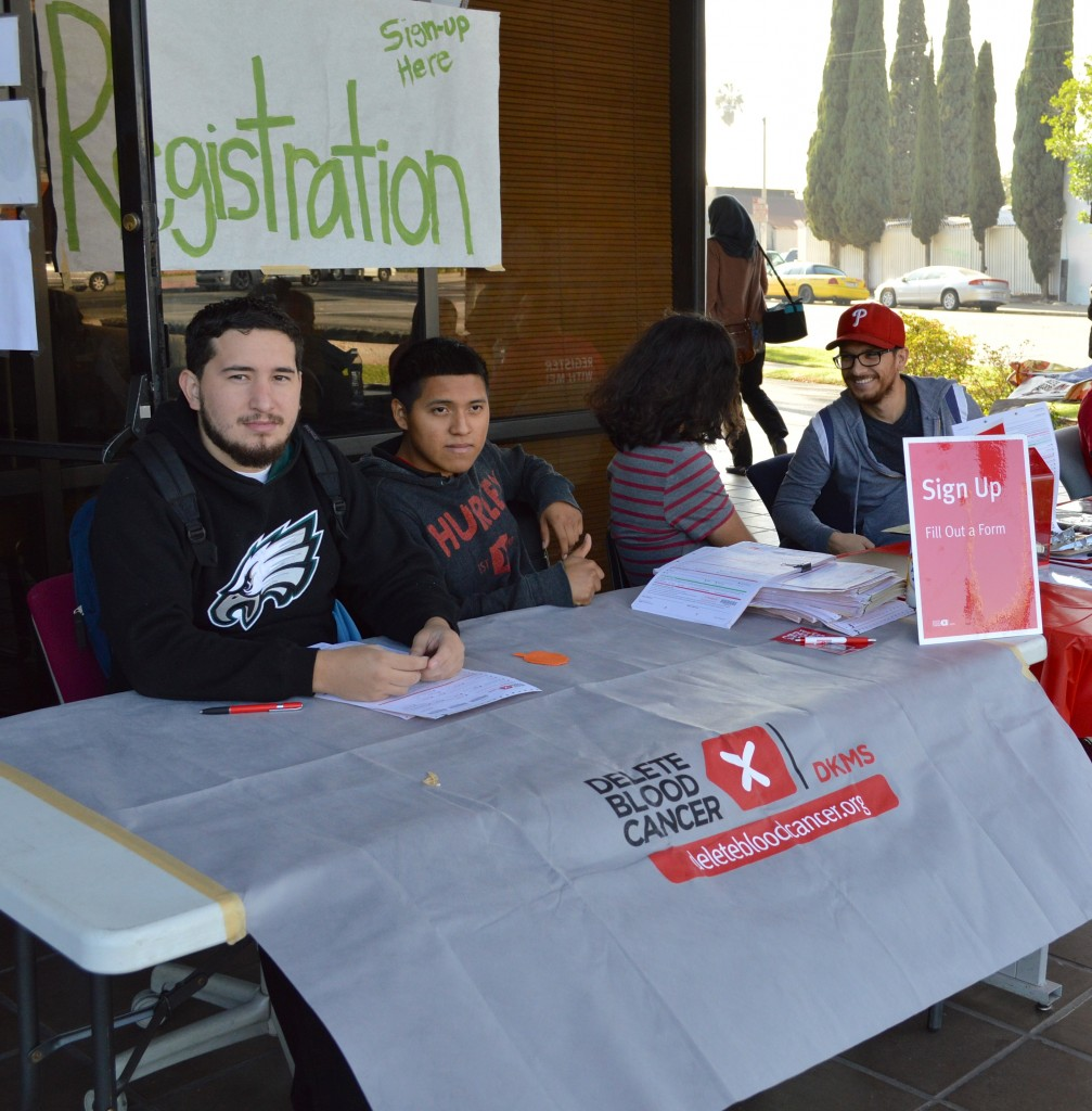 Students, staff, collecting monetary donations and registering participants.