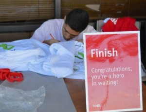 "Raymond Ortega, 17, at the finish line of the ''Drive for Life"" that was inspired by his Aplastic Anemia."